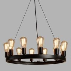 SHOP NOW: Crafted of iron with an industrial-style black finish, our exclusive round chandelier fills a room with the rustic warmth of 12 Edison lights. All 12 lights are included with the chandelier for a brilliant value. Edison Bulb Chandelier, Edison Lampe, Industrial Chandelier, Round Chandelier, Edison Lighting, Industrial Lighting, Chandelier Lighting, Industrial Style, Edison Bulbs