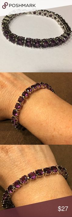 🎁Deep Amethyst CZ & 18K White GP Tennis Bracelet Beautiful deep Amethyst cubic zirconia with 18K white gold plated tennis bracelet. These bracelets are gorgeous and very nice quality. They have a nice weight to them, are incredibly sparkly, and you will get compliments every time you wear it. Bracelet size is 6mm x 180mm and stone size 5mm x 7mm x 15. Vivid Jewelry Jewelry Bracelets
