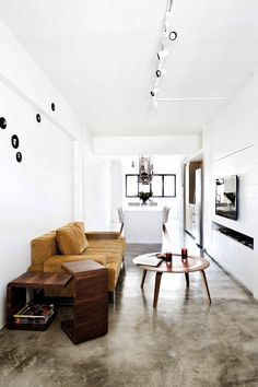 These white walls and white track lights. Concrete floor color?