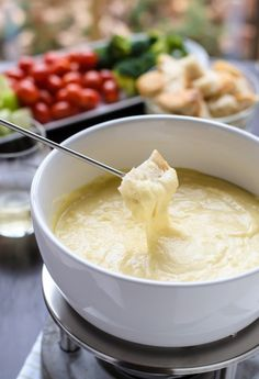 This post covers how to make cheese fondue at home, from the kinds of cheese to use to what to dip in fondue. Spoiler: homemade cheese fondue is EASY. You'll feel inspired to throw a fondue party by the end! Dips Für Fondue, Cheese Fondue Dippers, Fondue Raclette, Swiss Cheese Fondue, Fondue Ideas, Fondue Party, Gruyere Cheese, Cheddar Cheese Fondue Recipe Without Alcohol, Appetizer Recipes