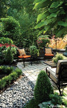 Beautiful backyard garden and stone patio design.