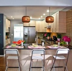 Hang pendants over a breakfast bar or island. They provide a lot of mood, shape, and light. And they don't have to be expensive.