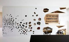 http://dornob.com/beautiful-balance-white-wall-interior-pine-wood-panels/#axzz2qdFjVZX0