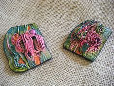 2 polymer clay pendants made in the workshop of jana robert benson in