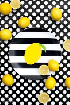 Black, White and Lemon melamine plate from A Blissful Nest styled and photographed by Shay Cochrane. Image copyright Shay Cochrane 2013. Lemons, polka dots, product styling, commercial photography, creative styling, product styling, stripes, bold, yellow. www.shaycochrane.com www.ablissfulnest.com