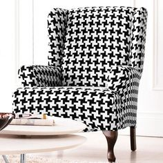 For the ugly (but in good condition) wing chair that came with the house. Sure Fit(TM/MC) Hudson Houndstooth Wing Chair Slipcover