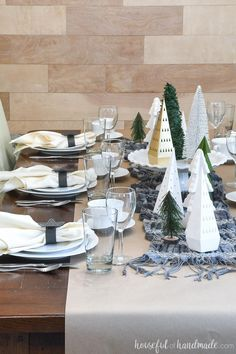 Learn how to ruse your paper Christmas decor to make a cozy papercraft winter tablescape. With a tutorial for making easy snowflake paper napkin rings. Winter Wonderland Theme, Winter Theme, Christmas Crafts, Christmas Decorations, Christmas Trees, Xmas, White Party Decorations, Winter Centerpieces, Simple Snowflake