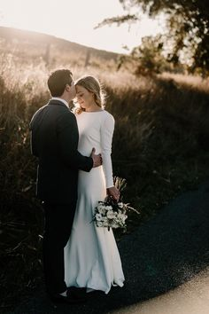 Minimalist bride in long sleeve wedding dress