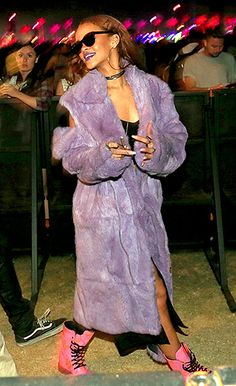 """Despite the scorching temps, the """"Bitch Better Have My Money"""" singer wore a pastel purple coat with hot pink lace-up boots for the event. She accessorized with a black choker necklace and dark sunglasses on April 11."""