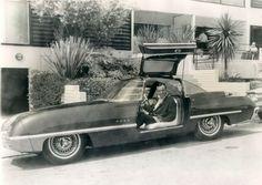 Jack Lemon in a 1963 Ford Cougar Concept Car