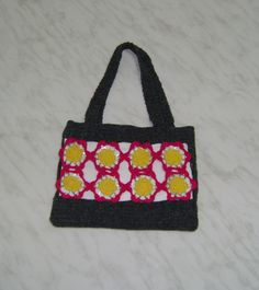 crocheted purse with flowers from metal bottle rings