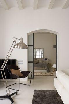 Arched doorway into bedroom with great privacy door.