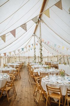 Pretty Quaint Country Marquee Wedding Bunting Wooden Chairs Tent UK http://jamesandlianne.com/