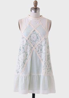 Lovely feminine details on this high-neck drop waist tunic dress