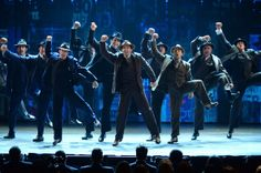 """The cast of """"Bullets over Broadway"""" performs onstage during the 68th Annual Tony Awards at Radio City Music Hall on June 8, 2014 in New York..."""