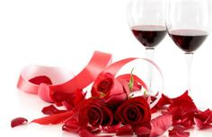 Valentine's romance two glass of red wine and three red roses and ribbon - romantic thoughts