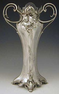 PAIR OF LARGE ART NOUVEAU WMF VASES - Manufacturer	WMF Designer	 Description	An impressive pair of polished pewter Art Nouveau vases with glass liners Country of Manufacture	Germany Date	1906 Marks	Marked to foot