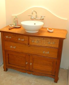 Re-purposing an antique dresser using a contemporary or modern sink brings the antique dresser up to date.