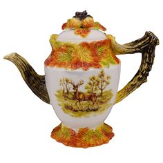 Features:  -Hand crafted / Hand painted.  -Hand wash.  -FDA Approved.  -Hunt Harvest collection.  --On one side of the teapot is a decal of a pheasant and on the other side is a decal of a deer. The h