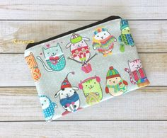 A personal favorite from my Etsy shop https://www.etsy.com/listing/468416540/knitting-kitties-zipper-pouch-gold