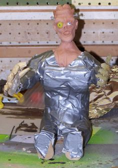 The body is made of scrap wood, wire and #duct tape.
