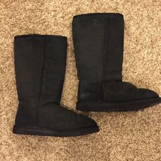 % Authentic UGGS Black Tall Black Tall, slightly worn uggs! Great condition as u can see from the bottom. Inside fur as comfy as if they are new. I have the short and prefer those over the tall. UGG Shoes Winter & Rain Boots