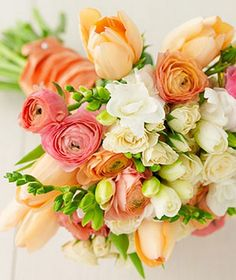 Great french tulips in peach with white freesia and spray roses, and coral pink ranunculus. #bouquet