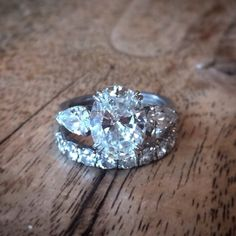 Oval with Pear Side Stones Engagement Ring