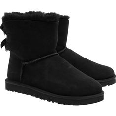 UGG Mini Bailey Bow Black // Lambskin boots with bow ($195) ❤ liked on Polyvore featuring shoes, boots, uggs, black bow shoes, party boots, mini boots, black shoes and short boots