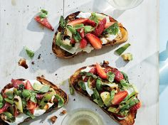 Grilled Strawberry-Avocado Toasts with Burrata | These Grilled Strawberry-Avocado Toasts with Burrata get flavor from burrata, scallions, balsamic vinegar and more. Get the recipe from Food & Wine.