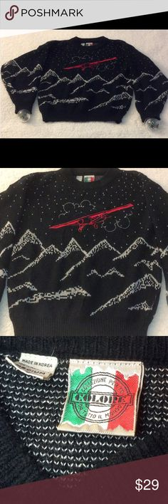 "VNTG Men's Airplane and Mountains Black Sweater M Vintage Men's Airplane and Mountains Black Sweater SZ M runs big. Will fit a ladies size XL. It's a biplane, mountains and snow.  Black , white and red sweater. measures 44"" at chest, 26"" long from shoulder, 23"" between shoulders and arms are 24"" long. The back has the same design with the plane. . Made in  Korea in Acrylic can be machine washed in warm water This is a vintage Pre-loved sweater. NO TRADES colore Sweaters Crewneck"