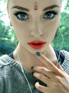 Oh my God she's the most beautiful girl I've ever seen.  Look at those eyes!!  And the vertical labret piercing, gorgeous.