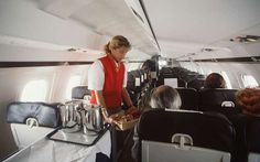 What Was It Like to Travel the Decade You Were Born © ullstein bild via Getty Images 1990s Mode of Transportation: AIRPLANE <> A stewardess serves passengers in the economy seating area. By the 90s, air travel had become the new normal for long-distance travel.