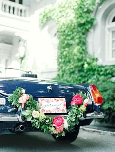 just married garland on the getaway car
