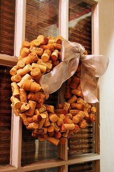 DIY: Wine cork wreath ... maybe I can finally get all the corks out of the junk drawer! by yesenia