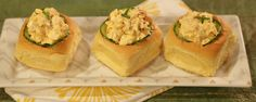 Picnic deviled eggs sandwiches! Line the holes in the rolls with cucumber slices to prevent roll from getting soggy