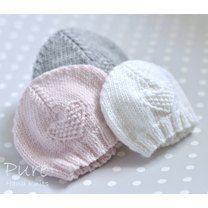 Knit this precious 4 Ply preemie and newborn baby hat to keep little ones warm. This simple little moss stitch heart baby hat is very easy and very quick to knit. the perfect project for a new knitter. The hats in these photos have been knitted in Rowan' Baby Knitting Patterns, Baby Hat Patterns, Baby Hats Knitting, Knitting For Kids, Easy Knitting, Knitting Projects, Knitted Hats, Newborn Knit Hat, Newborn Hats