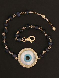 Gold and Sapphire Evil Eye Bracelet at London Jewelers!