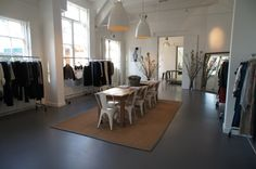concrete floors + lighting + chairs + table