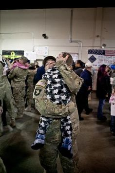 SFC Keith J. McDonald of the Mass. National Guard's 26th Yankee Brigade is reunited with his son, Nicholas, after a ten month deployment in Afghanistan.