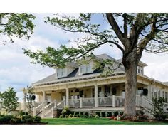 This is our dream house!!!  Perfectly grand and Southern with a huge wrap around porch! (This is actually an elegant restaurant in Louisville, Corbetts.)