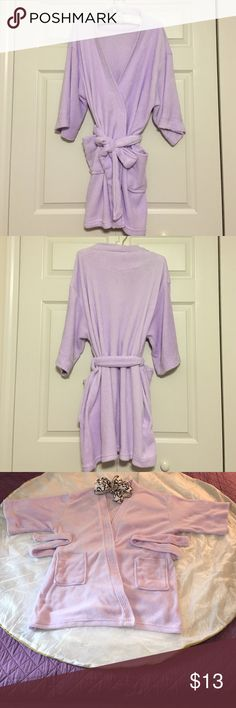 """SNUGGLY, SOFT BATHROBE NWOT - it was a gift from a friend. (She didn't realize how warm Florida is year-round.)  Gorgeous, light lavender robe. It could also be used as a pool cover-up!  Comfy, plush material. Features the following: * 2 front pockets * An interior tie * A removable exterior tie Measurement: 34"""" (L) from shoulder to bottom hem. 100% polyester fabric. Blue Star Intimates & Sleepwear Robes"""