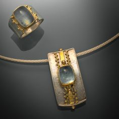 Gold, silver, and aquamarine ring and pendent by Regina Imbsweiler