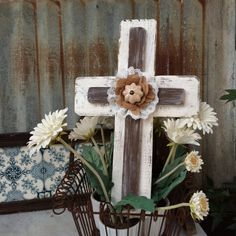 Shabby Chic cross with reclaimed wood, has a rustic white and chalky brown patina accented  with a cream porcelain knob, burlap rose & lace. 1st layer painted in rustic white and crème patina. 2nd layer is painted in a  chalky brown patina.