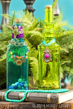 For a bohemian feel, embellish colored bottles with beads and baubles from the jewlery department.
