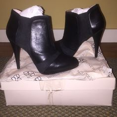 BCBG Booties Black leather and cloth BCBG generation heels. Never worn. PERFECT condition, still wrapped and boxed! BCBG Shoes Ankle Boots & Booties