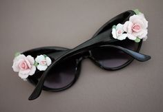 Floral decorated sunglasses. Cute but possibly annoying? Not sure.