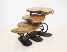 Ammonite Nesting Tables with wrought iron bases.