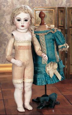 French bisque Bru doll, leather body, beautiful dress