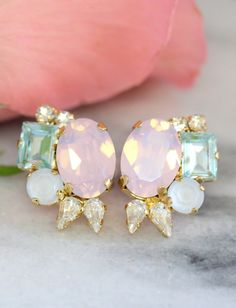 Pastel Earrings, Rose Quartz Serenity Earrings, Bridal Cluster Earrings, Pink Opal Bridal Earrings, Swarovski Bridal Earrings,Pink Studs  Dazzling Post Cluster Crystal earrings feature a Marquise Step Cut, Oval and Diamond cut crystals set on a secure prong settings. The perfect shade for cocktail parties or to add a touch of color to your wedding ensemble  Petite Delights is an Official SWAROVSKI® Branding Partner Our brand is legally licensed & authorized By Swarovski Company for high q...
